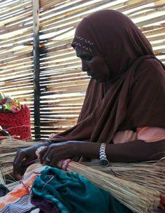 Ethiopia | Woman makes straw sleeping mats at Bokolmanyo camp.