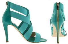 Oh how I love these shoes. Italian-made teal colored zipper sandals.