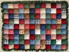 "Puff quilt? Wow! In the early days of quilting, pioneer grandmas made sturdy quilts out of fabric scraps. They cut squares of fabric, and filled them with batting. When the quilt was made by sewing these ""puffs"" together and placed on a bed, it looked just like a pan of fresh biscuits. Hence, these quilts were often called ""biscuit quilts."""
