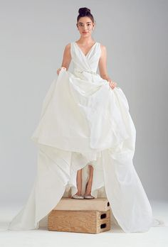 Brides.com: Wedding Dresses We Love For Under $1,500. Generous folds and unembellished matte taffeta give this ball gown a couture feel.   Taffeta wedding dress with a beaded belt, $1,099, Alfred Angelo  See more Alfred Angelo wedding dresses.