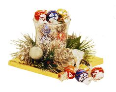 We've taken a hurricane candle holder centerpiece and filled with it with luscious Lindor chocolate truffles to make an elegant gift this holiday season. Lindt Truffles, Chocolate Truffles, Candle Centerpieces, Candles, Holiday Gifts, Christmas Gifts, Hurricane Candle Holders, Lindor, Christmas Gift Baskets