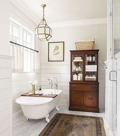 Wood hutch in the bath.  Great idea!