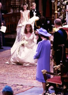 The royal curtsy is one of the most intriguing traditions. And from Meghan Markle, Princess Diana, Duchess Catherine and Sarah Ferguson, we've rounded up the best royal curtsies of all time. Royal Wedding Gowns, Royal Weddings, Wedding Dresses, Royal Life, Royal House, Sarah Ferguson Wedding, Prinz Andrew, Sarah Duchess Of York, Eugenie Of York