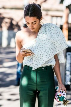 high waisted green dress pants, off the shoulder blouse, multi-colored clutch, modern yet classic, love.