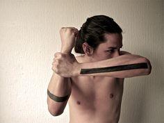 http://slodive.com/wp-content/uploads/2013/04/arm-tattoo-ideas-for-men/line-tattoo-ideas.jpg