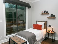 This downstairs boy's bedroom comes with a great view and some special features a la Joanna.