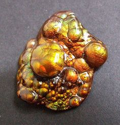 "Fire Agate Different from ""fired"" agate, which is a heat treatment.  This occurs naturally.  Both are beautiful."