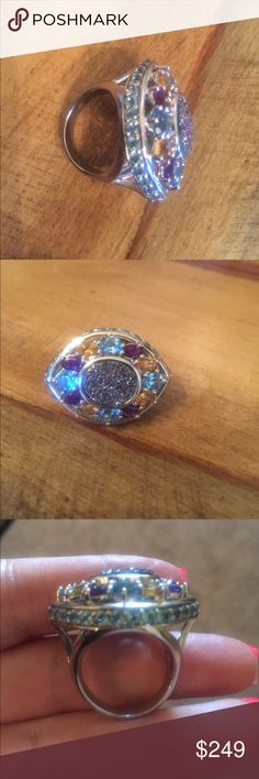 WOW gemstone drusy Druzy sterling silver ring Go big and fabulous or don't bother😂 When you look straight on you see a beautiful titanium Drusy surrounded by amethyst citrine & blue topaz. The sides are covered w 28 blue topaz stones! It looks like the angel evil eye protector. I have 2 of these & I'm keeping one. Please look @ quality of the amethyst & citrine they're both beautifully saturated as well as the under gallery is finished w scrolling hearts. This has designer quality…