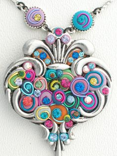 Tell Santa you want to register for my Foxy Epoxy Heart Pendant Class at Bead & Button in June. Loaded with Swarovski sparkles and soooooo fun to make!  http://www.beadandbuttonshow.com/