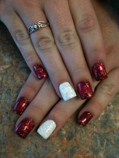 Red acrylic nails with glittery white accent
