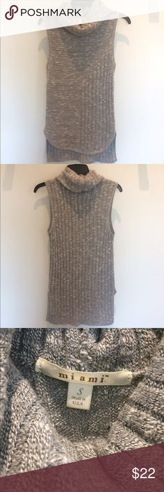 """Sleeveless turtleneck sweater Sleeveless turtleneck knit sweater. Longer in back. I'm about 5'3"""" and front hits me mid-thigh. 53% cotton, 34% acrylic, 13% polyester. Only worn once. miami Sweaters Cowl & Turtlenecks"""