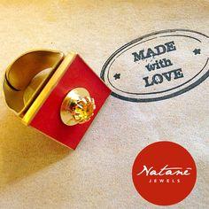 Natanè Planet ring red color on a serviette. #ring #anello #anelli #colors #red#woman #fashion #style #outfit #swarovski #jewel #bijoux #rosso #serviette #fashion #girl #natanè