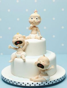 Crying Babies by Debbie Brown Cakes. You need to get her book with these baby instructions in it.........hilarious faces to impress first time parents-to-be!