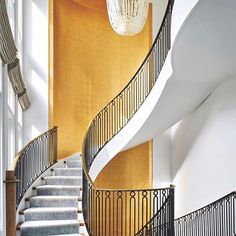 Gold leaf wallpaper envelops this gorgeous staircase @randallarchitects #interiors #architecture #interiordesign #spiralstaircase #chicago