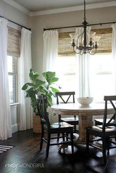 Farmhouse dining table,window shades,fiddle leaf plant,