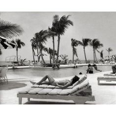 Bahamas young woman lying on lounge chair at poolside Canvas Art - (18 x 24)