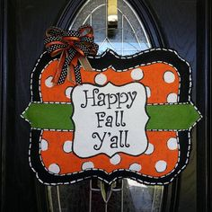 This fun fall door hanger would make a happy bright addition to your door this fall. Each door hanger is protected with a UV ray and water sealant. Paint color and ribbon choices can be customized to your liking. **REMEMBER** to notify me of personalization and/or customization request.  Proudly made in Angier NC, USA.  **COUPON** If you are local to Angier or surrounding areas, please enter coupon code PICKUP at checkout to waive shipping charges. We will contact you when your order is…