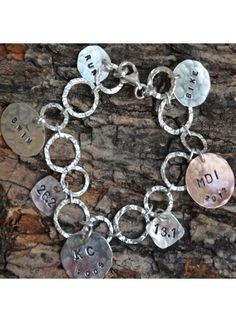Triathlon bracelet in stock - Order Now. Celebrate your achievements with this rock star triathlon bracelet. One copper and six sterling silver run charms are included to commemorate your races. Monogram Necklace, Personalized Necklace, Personalized Gifts, Running Jewelry, Mommy Necklace, Gifts For Runners, Hand Stamped Jewelry, Anniversary Gifts, Bracelets