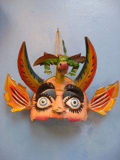 Bolivian Dragon Face Mask - made with recycled tin - vintage from 1970s. $85.00, via Etsy.