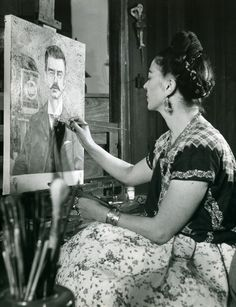 Frida Kahlo working on a painting