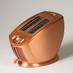 A welcome addition to any kitchen, this copper toaster from Jenn-Air has extra-wide slots for bagels and a variety of breads. Seven shade settings allow you to brown as much or little as needed.