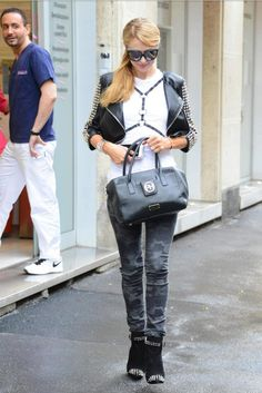 Paris Hilton wearing Philipp Plein Leather Airglow Studded Jacket, Philipp Plein My Boo Spike Ankle Boots, Chanel CC Lucite Transparent Cuff, Paris Hilton Leather Straps T- Shirt and Italia Independent I- Plastik Suede Sunglasses