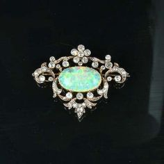 An opal and diamond brooch/pendant, circa the central opal cabochon, to an openwork cartouche-shaped border of scrolling flowers and foliage set with old brilliant and single-cut diamonds, width Bijoux Art Nouveau, Art Nouveau Jewelry, Opal Jewelry, Fine Jewelry, Antique Jewelry, Vintage Jewelry, Love Knot Ring, White Topaz Rings, Diamond Brooch