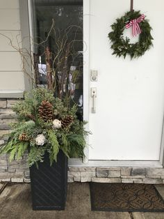 This January installation included sourcing the planter that had height to help offer some privacy. Mixed evergreens, birch poles and curly willow, as well as Sugar cones and dried artichokes are used. Winter Container Gardening, Gardening Tips, Christmas Planters, Christmas Wreaths, Sugar Cones, Curly Willow, Recycled Rubber, Artichokes, Winter Garden