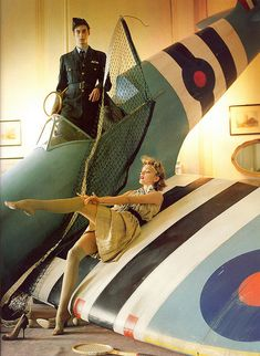 Fashion spread with WWII vintage references on a Spitfire.