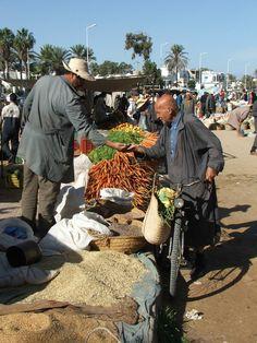 Carrot vendor and customer, Houmt Souk market, Djerba