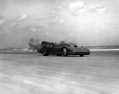 "Sir Malcolm Campbell set his first land speed record of 330 miles per hour in his race car, the ""Bluebird,"" at Daytona Beach in 1935. 
