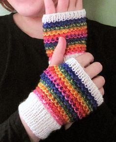 Free Knitting Pattern for Rainbow Slip Stitch Mitts - These fingerless mitts feature easy slip stitch colorwork. Perfect stashbuster for using up scrap yarn.The designer Emma Welford says theytake only a few hours to make. Mitts are worked flat and seamed.