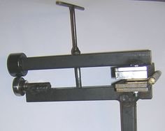 English Wheel by Richard Ferguson -- Homemade English wheel constructed from tubing, round bar stock, steel plate, bearings, a hinge, nuts, and bolts. http://www.homemadetools.net/homemade-english-wheel-18