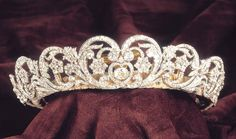 ~ THE SPENCER TIARA ~ Owned by the Spencer family, Worn by Lady Diana Spencer at her marriage to Charles, Prince of Wales in 1981. The tiara includes diamonds in silver settings mounted in gold in various floral shapes: stylized tulips, star-shaped flowers, and scrolling foliage. It was worn by both of Lady Diana Spencer's older sisters, Jane and Sarah, at their weddings. It went back to the Spencer family upon Diana's death.