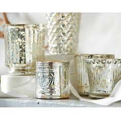 This is a favorite set this year and used in many weddings and cocktail parties.   Mercury Glass Votives  I  ballarddesigns.com