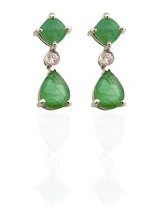 A beautiful contrast between the bold green emeralds nestled with a subtle diamond in the centre creating a balance with an elegant stylish design.  A 10kt white gold pair of emerald drop earrings  Total emerald weight - 6.08ct. Total diamond weight - 0.09ct.  $5695