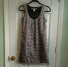 I just added this to my closet on Poshmark: NWOT Metallic little dress. Price: $10 Size: XS