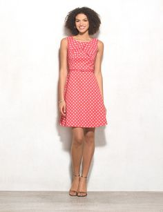 Turn all eyes on you in this flirty, vibrant polka-dot dress. We're loving the retro vibes it's giving us, plus it's in one of our favorite silhouettes! Allover coral and white polka dots. Imported.