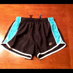 Roadrunner women's running shorts. Very cute women's running shorts made by roadrunner sports.  Very soft and lightweight fabric.  Nice zippered pocket on back of short and small pocket on inside of waistband to hold ear buds.  100% polyester.  Brief sewn in insert. Roadrunner Shorts