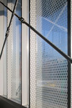 The Ohio State East Regional Chilled Water Plant by Leers Weinzapfel Associates, Boston, USA. Metal Panels/glass curtain wall. Steel braces support the facility's dramatic cantilever. The dotted ceramic frit shields the glass, except where it meets the columns.