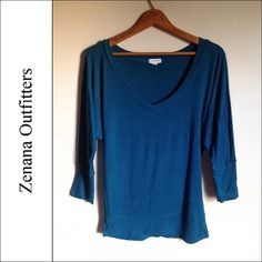 ZENANA OUTFITTERS | Teal V-Neck 3/4 Sleeve Top Brand: Zenana Outfitters Size: Medium Color: Dark Teal  This top is in good condition. It features a v-neck design and 3/4 length sleeves.  🔰 No trades. Please refrain from asking. 🔰 Negotiations will take place via the Offer button ONLY. Zenana Outfitters Tops Blouses