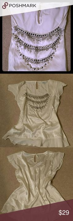 Silk top Worn once abd it's perfect for the season. Armpit to armpit 17 inches. Length 22 inches. Off white, with silver and pearl embellishment, no necklace needed. Express Tops