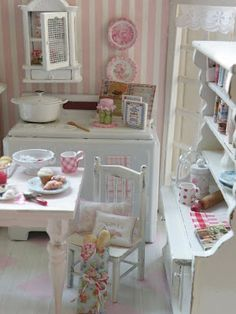 Cute little kitchen scene in white and pink.