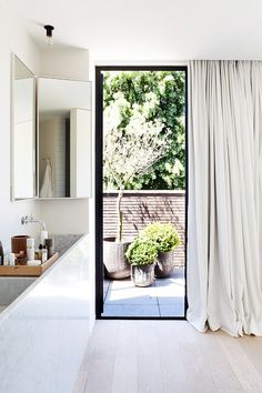 Love the skinny sink and the door leading to the backyard, and the luxurious curtains