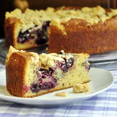 Cherry Swirl Almond Crumble Coffee Cake - a delicious almond and vanilla flavored cake gets a swirl of sweet cherry compote through  the cake before being topped by a buttery almond shortbread crumble.