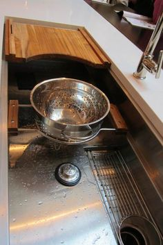 The 45-inch single sink has a tiered interior and slotted drain. Accessories include a sliding colander, utensil rack (which sits in the drain trough) and cutting board that includes knife storage and  a sharpening steel bar in back that can double as a small towel rod.
