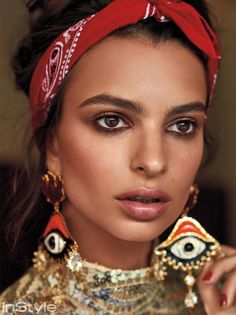 Getting her closeup, Emily Ratajkowski poses in Marc Jacobs sequined minidress with DSquared2 brass earrings