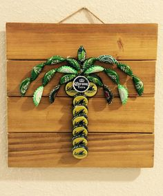 This Florida Inspired Palm Tree is a fun and unique addition to any beach or fun in the sun themed room! Made from bottle caps adhered to finished wood. Comes ready to hang