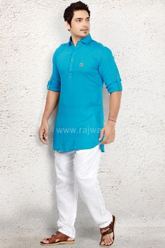 Attractive look in this Sky Blue coloured Voile fabric kameez crafted with fancy button. Paired with Linen fabric White coloured trouser. Pathani For Men, Fancy Buttons, Linen Fabric, Polo Ralph Lauren, Polo Shirt, Trousers, Suits, Amazing, Mens Tops
