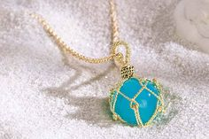 Have a special sailor on your list? The **Fish Float Sphere Pendant** is sure to please. Designed and made in Maine by nautical jewelers A.G.A. Correa & Son, the sphere is made from aqua chalcedony, and the 18-karat gold ropework is hand-twisted. $1,650, [www.agacorrea.com](http://www.agacorrea.com).